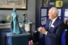 Roy Perry with the unveiled statue